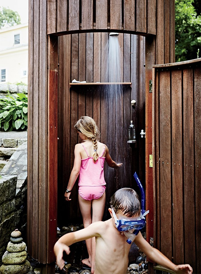"An outdoor shower was the family's first construction project. ""Doing the shower made us realize we can build things the way we want to build them,"" says Meg. Tagged: Bath Room and Open Shower. A Family Builds a Tiny Backyard Studio on an Even Tinier Budget - Photo 6 of 8"