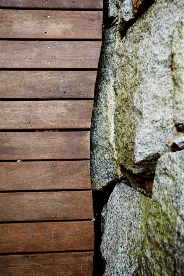 Design details include mahogany and granite where the deck meets a stone retaining wall. A Family Builds a Tiny Backyard Studio on an Even Tinier Budget - Photo 7 of 8
