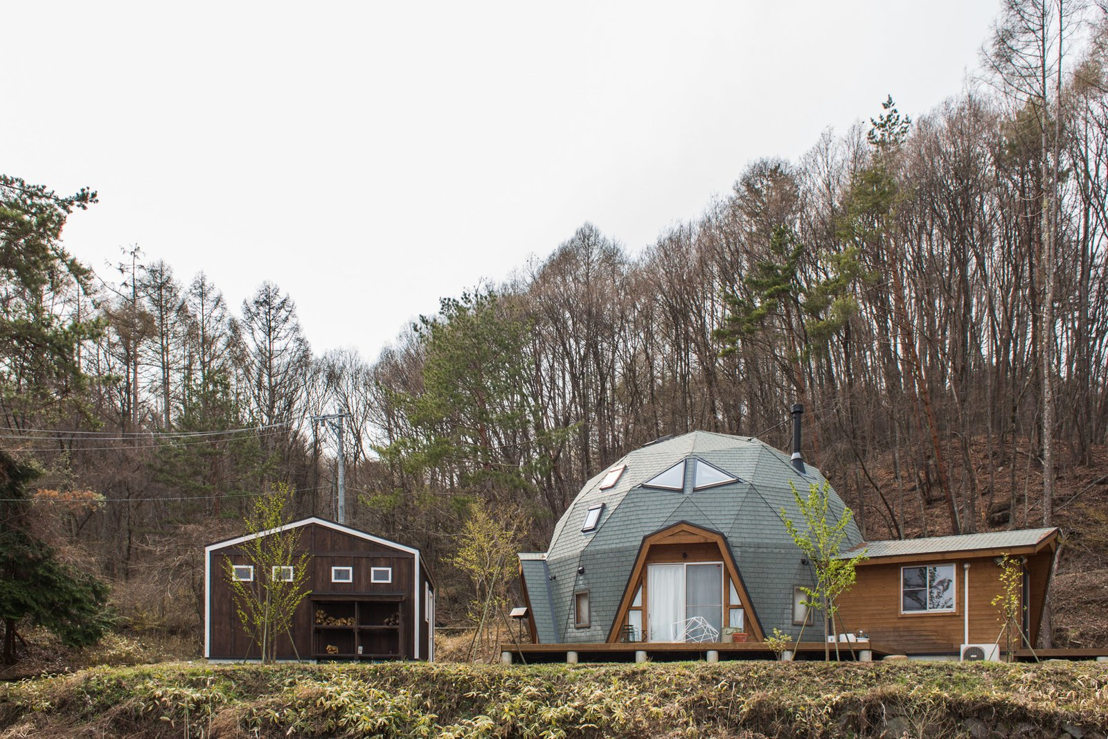 """I was looking into dome homes built by a company called Bess,"" Hasui tells FvF. ""Dome homes are strong and can withstand storms and natural disasters, and the space inside is such a unique shape and works well for sound.""  Tiny Homes  by Erika Heet from Tiny and Cozy Home in a Geodesic Dome"