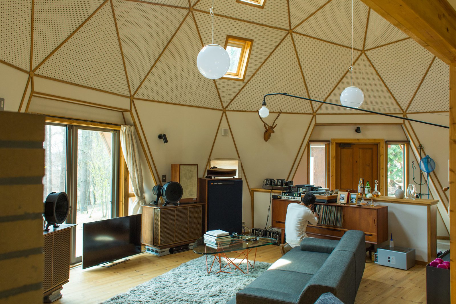 """It was always my dream to own my own audio set-up, and in my 50s – when I was finally able to build my own home – that audio dream came true,"" Hasui says.  Photo 1 of 1 in How To Install A Home Audio System With Remote Control Access On Your Own? from Tiny and Cozy Home in a Geodesic Dome"