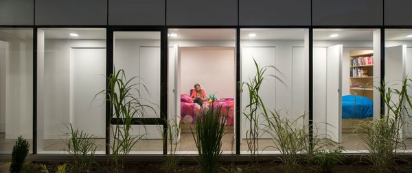 Childrens' bedrooms are reimagined as cozy private cubbies, much like sleeper cars on a train. These compact rooms were designed to encourage outside interaction with the rest of the household during the non-sleeping hours of the day. Sliding doors and baltic birch built-ins complete the rooms.