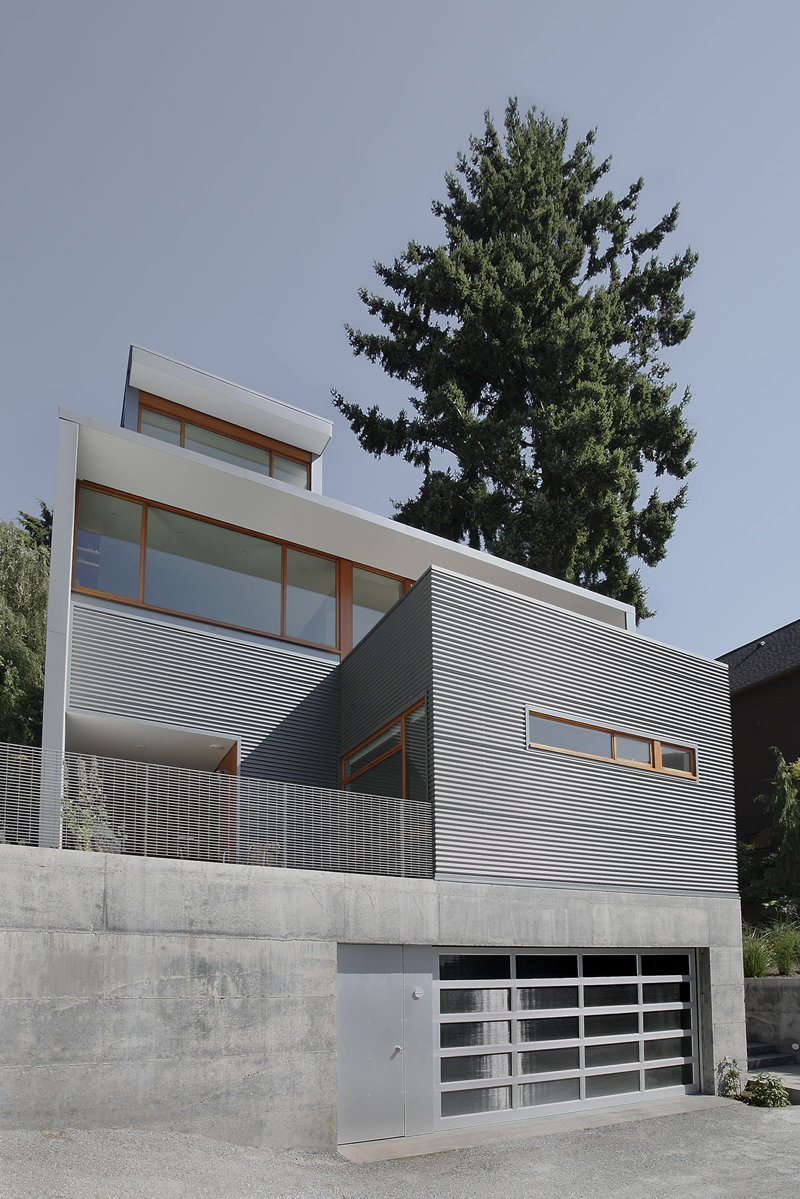"""A private terrace overlooks an alleyway on the main floor's southeastern end. """"[The home's] outdoor spaces are all to varying degrees extensions of interior space,"""" Schaer says. Seattle Home Carefully Blocks Out Neighbors, While Celebrating Natural Surroundings - Photo 10 of 11"""