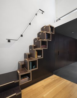 """8 Ways to Organize Your Books with Storage Cubbies - Photo 4 of 8 - Confronted with limited space to build the staircase needed to access the living area and bedroom on the second level, General Assembly designed a custom solution. """"These stairs are not an ideal design for everyone and shouldn't be used as primary stairs—we like to think of them more as millwork with a little bonus to it, than an actual staircase,"""" Zames says. """"The cube construction of the stairs actually came from a budget standpoint. We were very tight on budget and wanted to maximize the material as much as possible."""""""