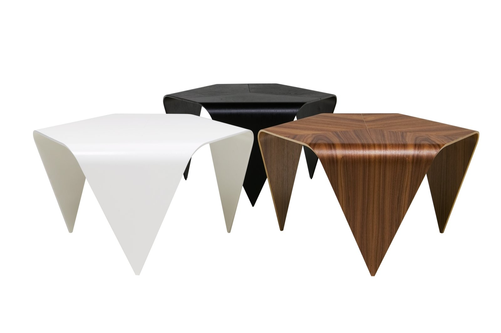 Tapiovarra's 1954 Trienna coffee table is made of three pieces smoothly conjoined to form one surface with six rounded edges. The tables, which are made of formed birch wood with surface veneer in walnut, are manufactured in Finland by Artek. 100+ Best Modern Seating Designs by Dwell