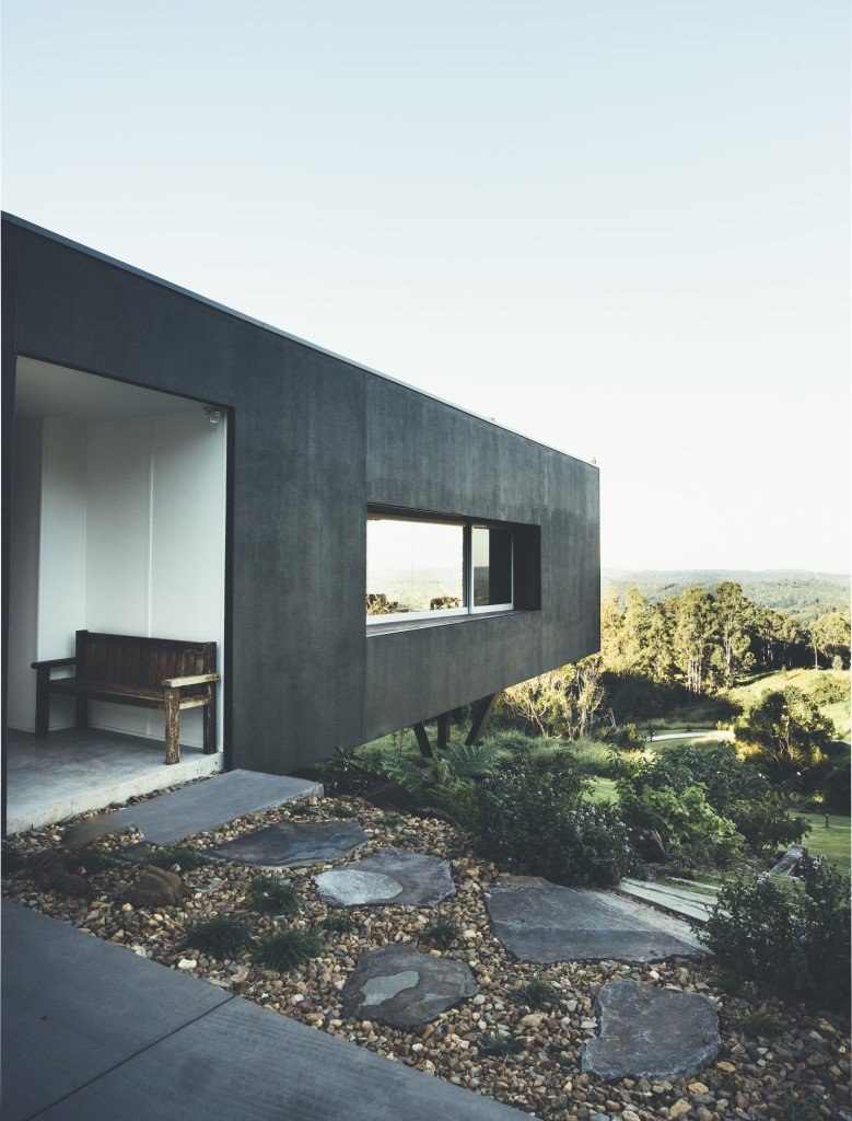 Located on a steep site with limited suitable building ground, the firm decided to cantilever the home over the hillside, which has the effect of helping the structure blend in with the landscape. Tagged: Exterior, House, Concrete Siding Material, Glass Siding Material, and Flat RoofLine.  Modern House Captures Panoramic Views in Australia by Allie Weiss from Picturesque Australian Homes