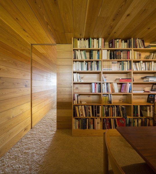 The library is accessed by a sliding wood door. Photo 8 of Refuge modern home