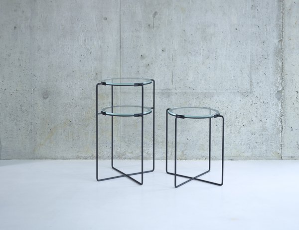 These iron side tables from designer Jasper Morrison are available with one or two tiers of glass.