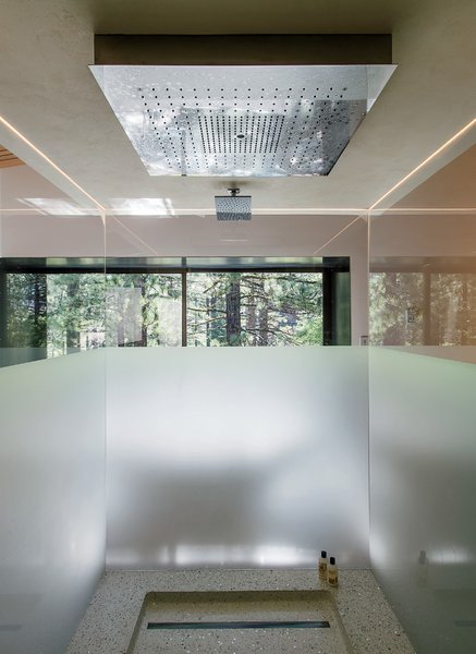 """""""The central vision was threefold: interiors that would bring the family joy, support their daily activities, and provide specific areas of refuge for each member and as a family,"""" says Chenault, who integrated a Hansgrohe Axor rain shower in the master bath, which has frosted glass."""
