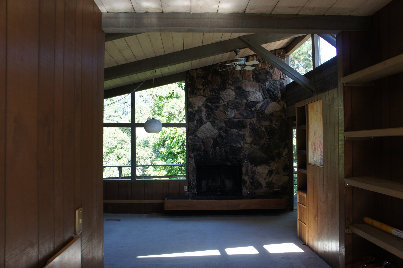 Before  In the original east-facing living room, the light was partially blocked by a poorly located fireplace.  Photo 3 of 10 in Bright Renovation of a 1970s Big Sur Home from Torres House