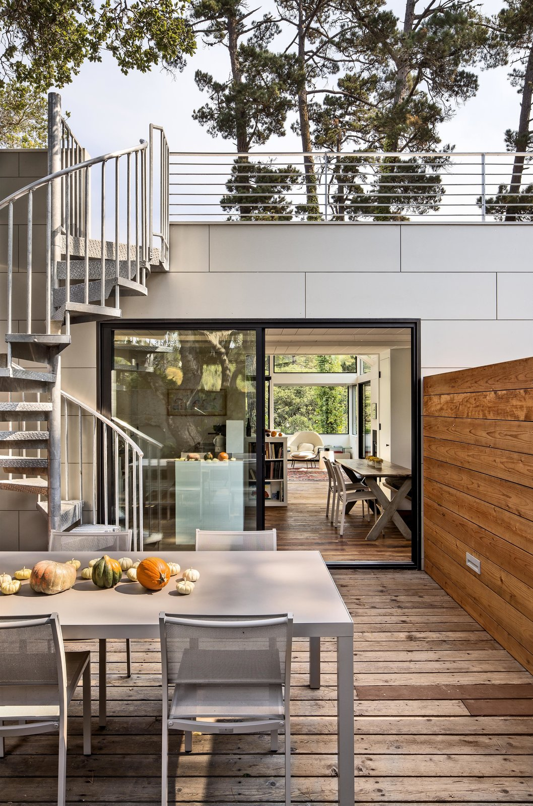 "The house is set on a forested hill, which means the backyard—though scenic—is too steep to enjoy. It's also perpetually shady. Schicketanz wanted somewhere she could soak in the sun, so she added a roof deck. ""It's really the only usable, large outdoor space I have,"" she says. Bright Renovation of a 1970s Big Sur Home - Photo 1 of 10"
