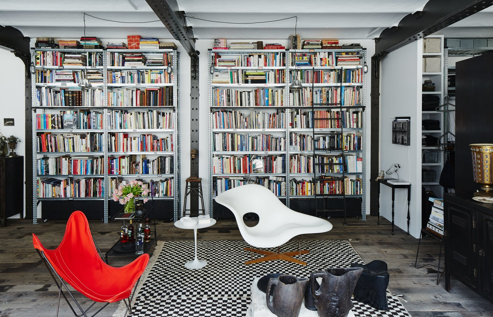 In the living area of Daniel Rozensztroch's Paris apartment, an Eames La Chaise and a butterfly chair complement a Moroccan Berber rug.  Photo 6 of 10 in 10 Modern Renovations to Unique Homes in France