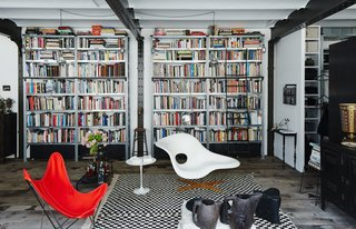 10 Modern Renovations to Unique Homes in France - Photo 6 of 10 - In the living area of Daniel Rozensztroch's Paris apartment, an Eames La Chaise and a butterfly chair complement a Moroccan Berber rug.