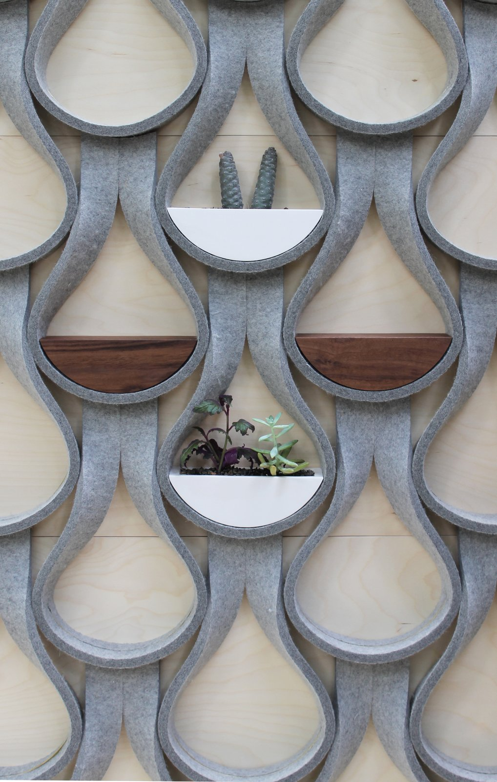 The Felt Droplet system by Garman Furniture consists of strips of natural wool felt that are capable of supporting a two-inch-deep shelf or planter.  Photo 7 of 15 in 14 Creative Ways to Design With Felt from Creative Paneled Wall Coverings You Should Try Now