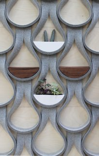 14 Creative Ways to Design With Felt - Photo 7 of 15 - The Felt Droplet system by Garman Furniture consists of strips of natural wool felt that are capable of supporting a two-inch-deep shelf or planter.