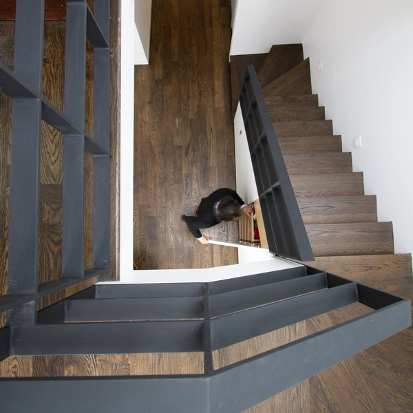 A second staircase—highly unusual in most Brooklyn homes—not only allows renters to access their unit without disturbing the homeowners, but also provides space for storage. To convert the space back into a 2,100 square-foot one-family home, the homeowners simply have to remove a small demising wall on the second floor and demolish the rental kitchen—a job that can be executed over the course of a long weekend. Photo 4 of Revitalization modern home