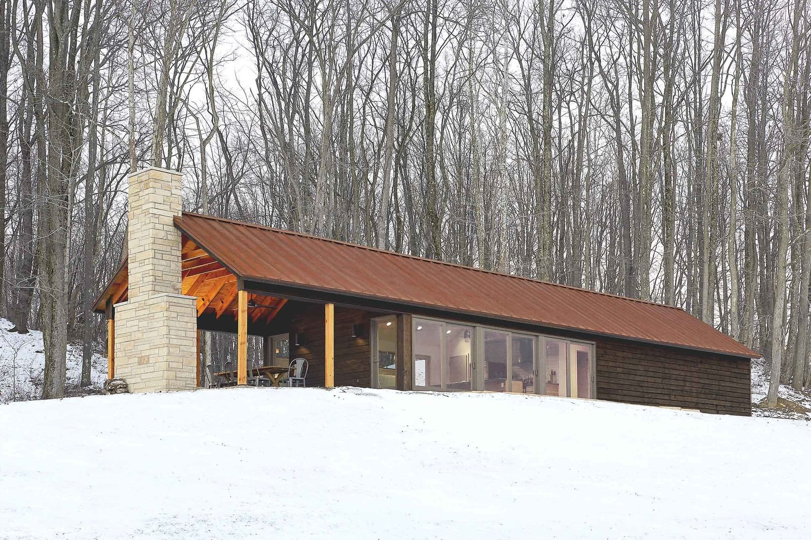 The father of architect Greg Dutton wished to build a cabin on the family farm, located within Appalachian Ohio and home to 400 heads of cattle. Dutton, of Pittsburgh and Columbus, Ohio-based Midland Architecture, presented this design as his father's birthday present in 2012. Finished in 2014, the 900-square-foot cabin operates entirely off-the-grid. Tagged: Exterior, House, Metal Roof Material, and Cabin Building Type.  Photo 78 of 101 in 101 Best Modern Cabins from Modern Homes on Farms