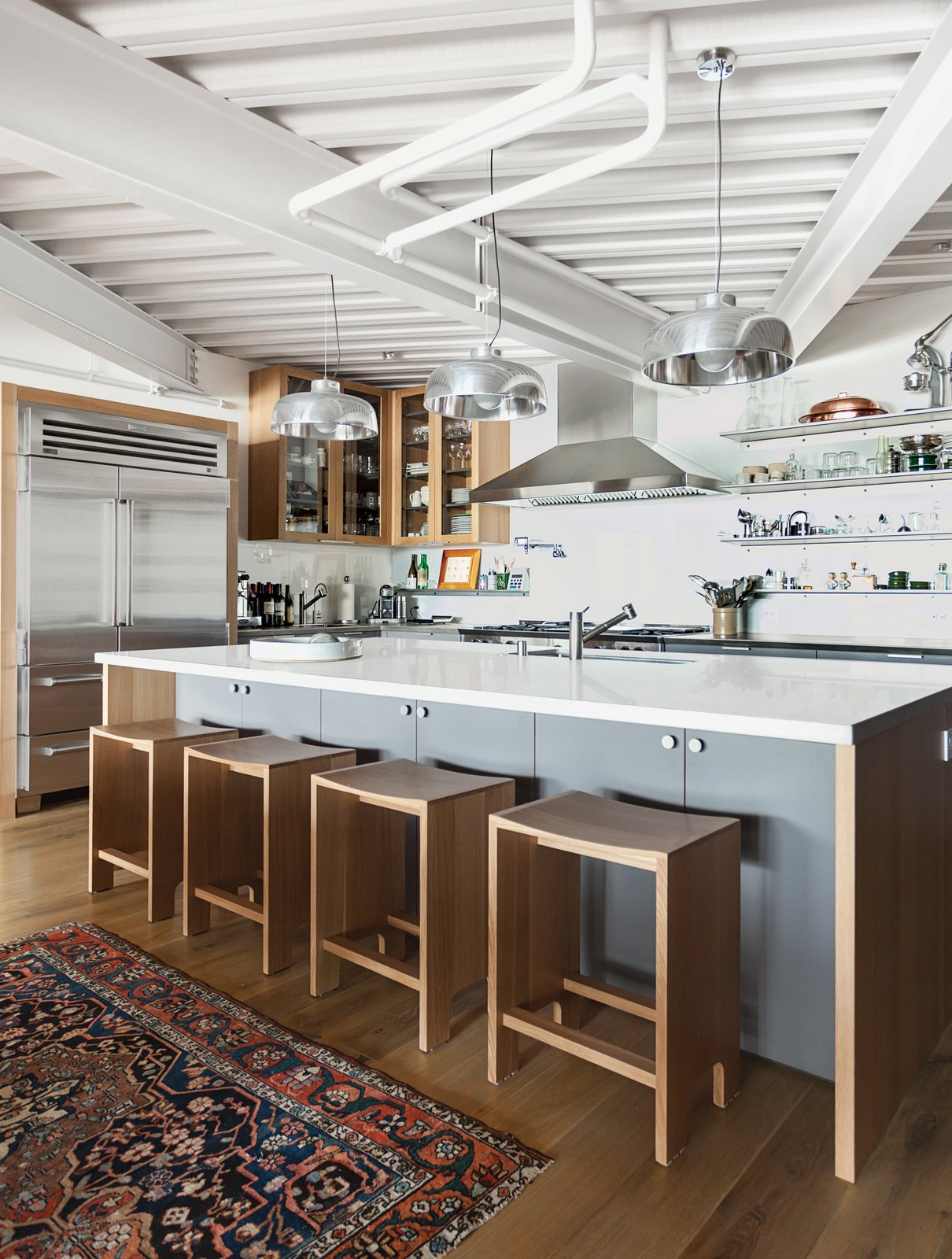 White also dominates the kicthen, also by Henrybuilt, with accents of stainless steel and wood.