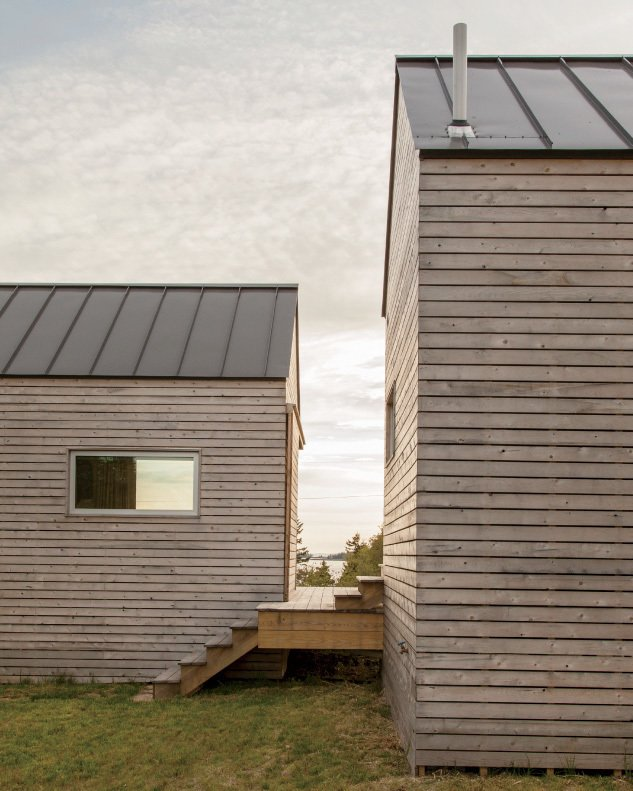 Sited parallel to each other, the two autonomous bedroom cabins frame perspectival views of the surrounding landscape. Exteriors of all three structures feature mitered corners and cross-laminated timber panels, all nailed by hand.