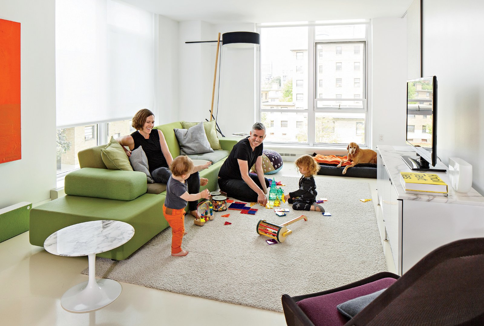 Smith, Grimley, Roen, and Mae gather around a Polder Sofa XL by Hella Jongerius for Vitra. The marble Saarinen side table is from Knoll and the Slow chair is by Ronan & Erwan Bouroullec for Vitra. Boston Renovation Accents Minimalist White with Rich Felt Murals - Photo 4 of 8
