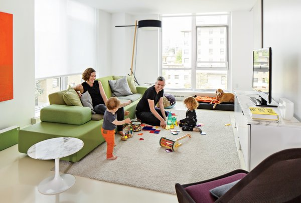 Smith, Grimley, Roen, and Mae gather around a Polder Sofa XL by Hella Jongerius for Vitra. The marble Saarinen side table is from Knoll and the Slow chair is by Ronan & Erwan Bouroullec for Vitra.