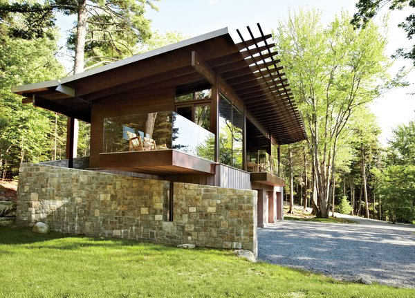 Frank lloyd wright inspired style and camping collide in for Frank lloyd wright inspired home plans