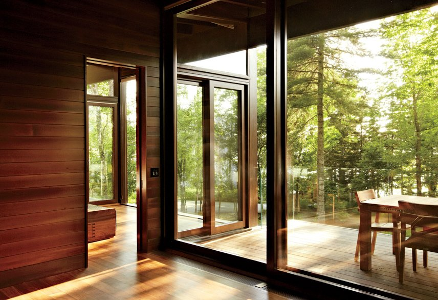 Douglas fir-framed windows by Dynamic Architectural Windows & Doors offer layered indoor-outdoor views. Tagged: Windows, Wood, and Sliding Window Type.  Photo 3 of 5 in Frank Lloyd Wright-Inspired Style and Camping Collide in Maine
