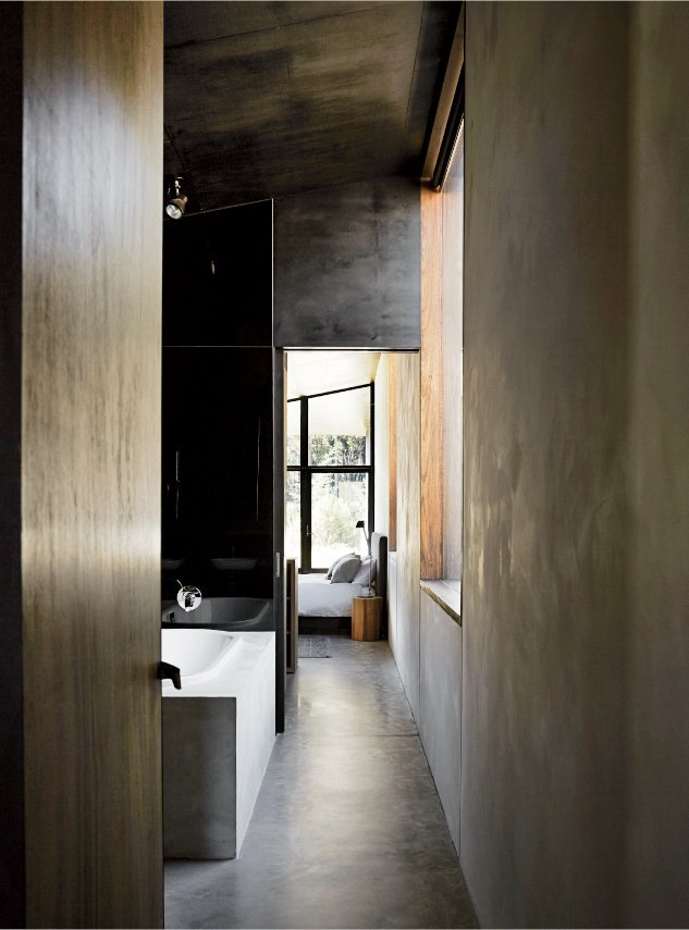 Dulux Ferrodor 810 industrial paint in Mid Grey, dark formply timber ceiling cladding, and concrete floors give the interiors a brooding intensity. Richly Furnished Home Frames Striking Landscape Views - Photo 3 of 10