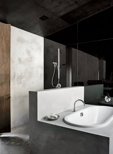 The en suite tub is by Kaldewei, the mixer is by Tonic, and the spout is by Sussex Taps.