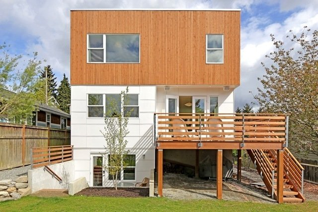 The exterior features cedar tongue and groove siding and James Hardie panels. Due in part to smart material choices, the house is 51% more efficient than the standard newly constructed home and 61% more efficient than a typical existing home. Prefab Home by Dwell