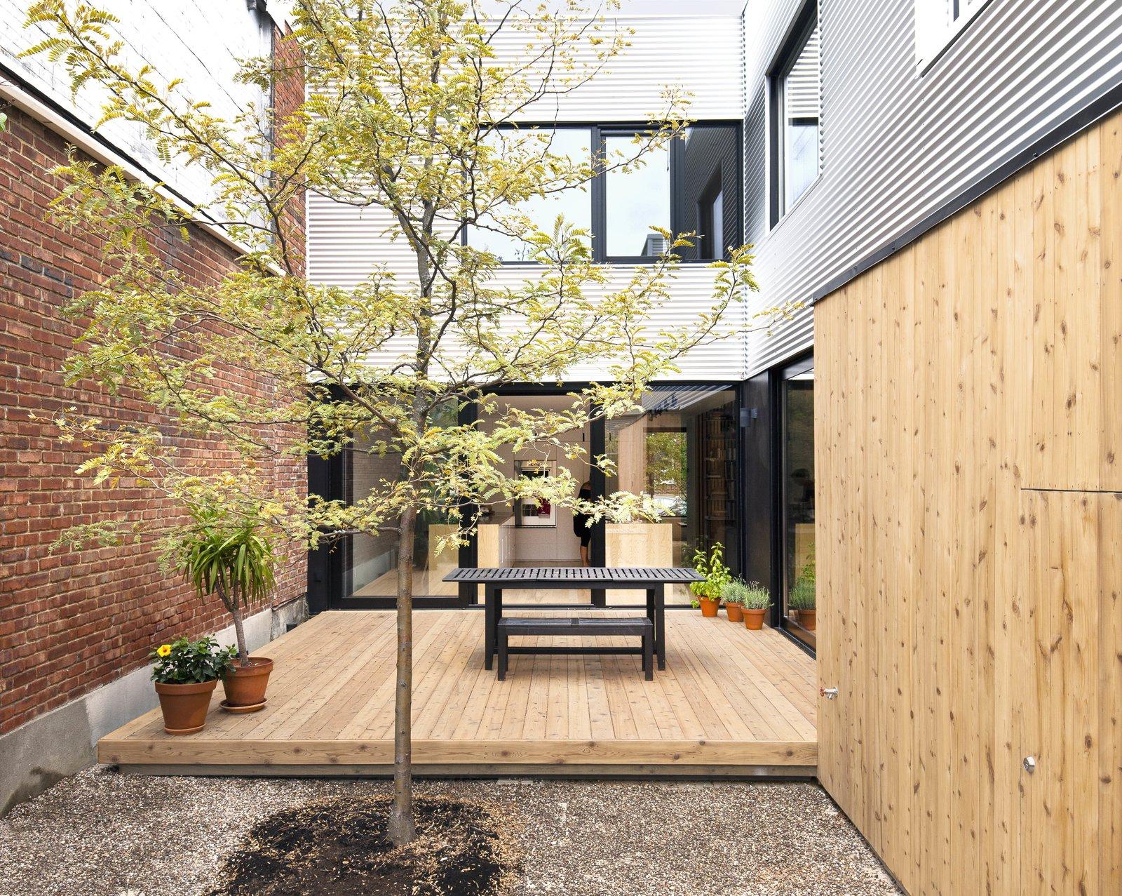 On the terrace, an eastern-cedar deck serves as a mid-city oasis.