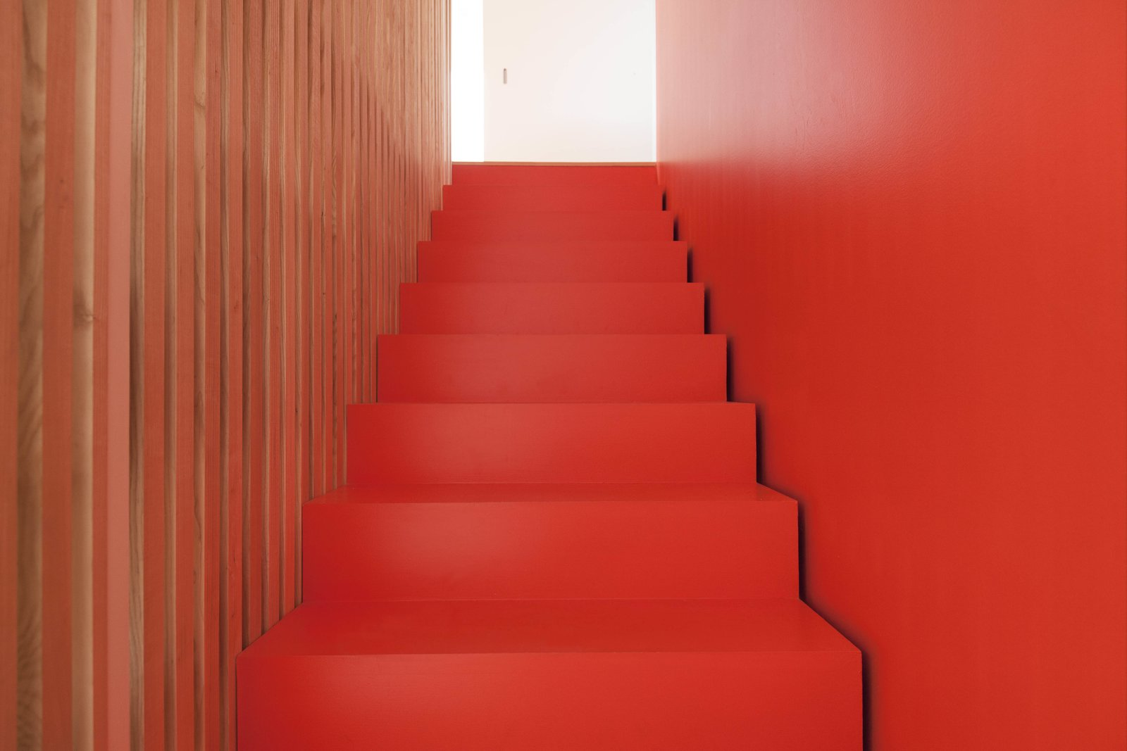 The stairs are coated in orange lacquer.