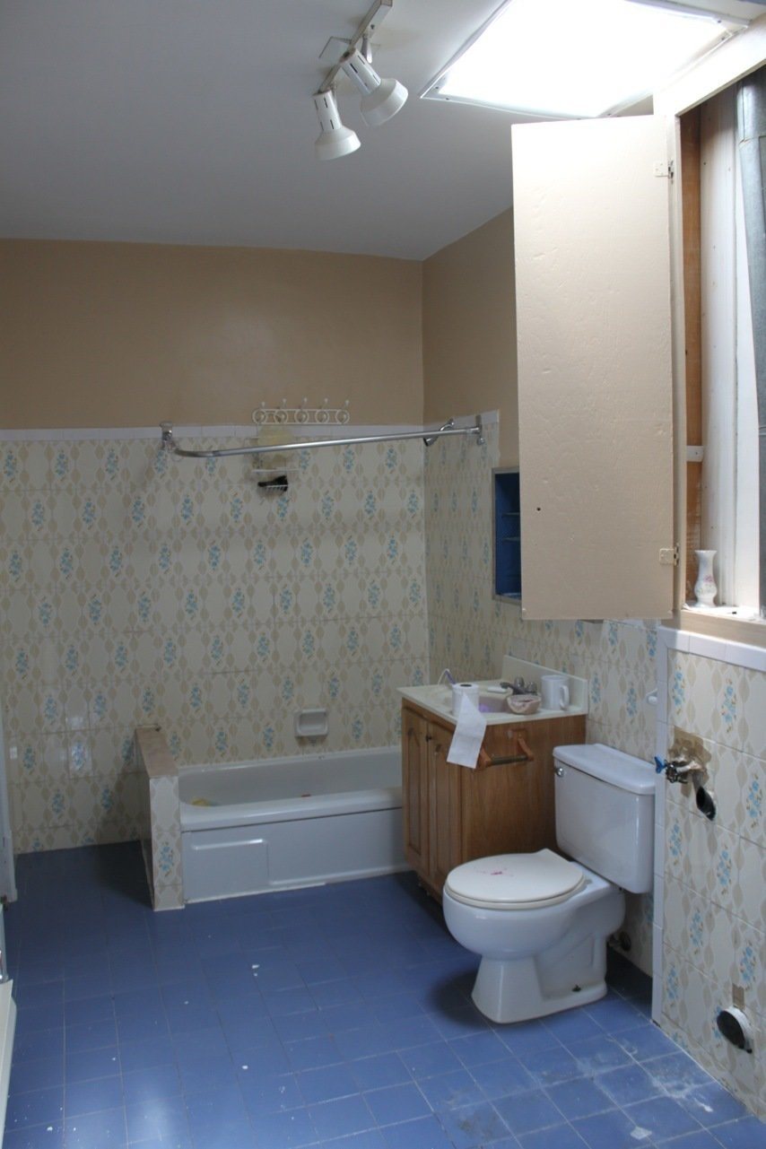 The master bathroom before the renovation.  Photo 11 of 15 in A Transformative Duplex Renovation in Montreal