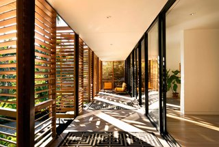 5 Sustainable Ways To Beat the Heat Without Air Conditioning - Photo 2 of 11 - In a Miami residence designed by Melissa and Jacob Brillhart, horizontal louvers on exterior shutters filter daylight while still creating a shaded indoor/outdoor area.