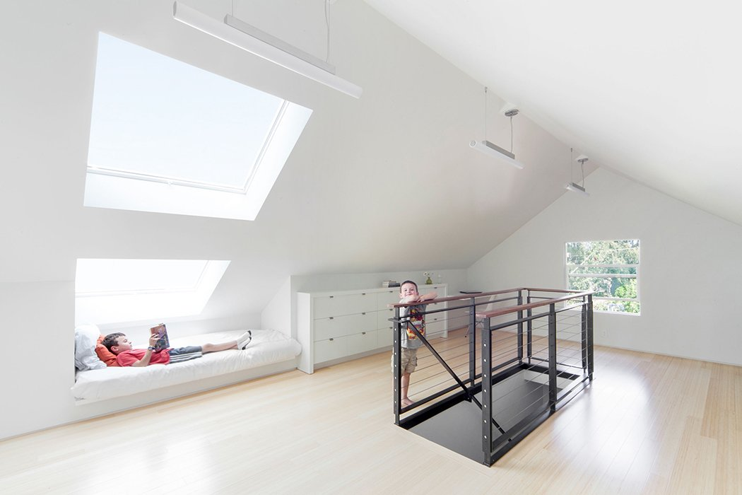 An added benefit of installing the skylights was adding headroom over the day beds, Smith says. Tagged: Living Room.  House ideas by Samuel Choi from A Musty Attic is Transformed Into a Luminous Loft