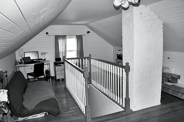 Before the renovation, the attic was a cramped, cluttered space—a feeling reinforced by the presence of a brick chimney that was later demolished and the relatively low 7.2-foot ceilings.