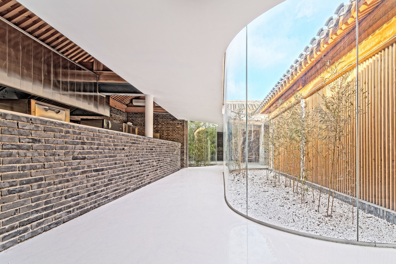 To ensure modern temperature control, the building had to be enclosed. The architects installed transparent glass walls to create a constant visual connection to the building's historic features. An Historic Beijing Structure Gets a Modern Makeover - Photo 3 of 7