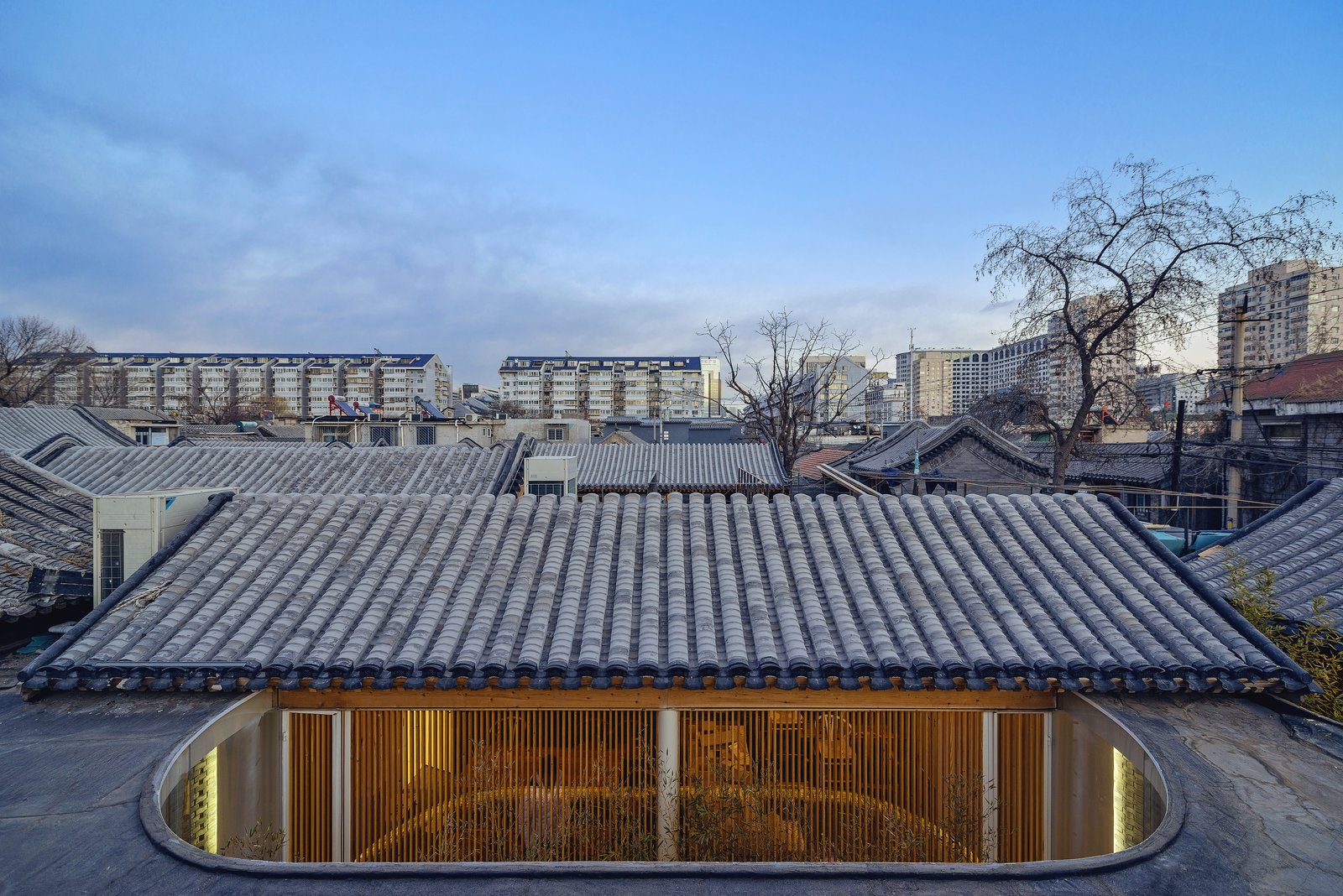 The roofs were also renovated but maintain their traditional pitched roofs. The new glass enclosure can be seen below.