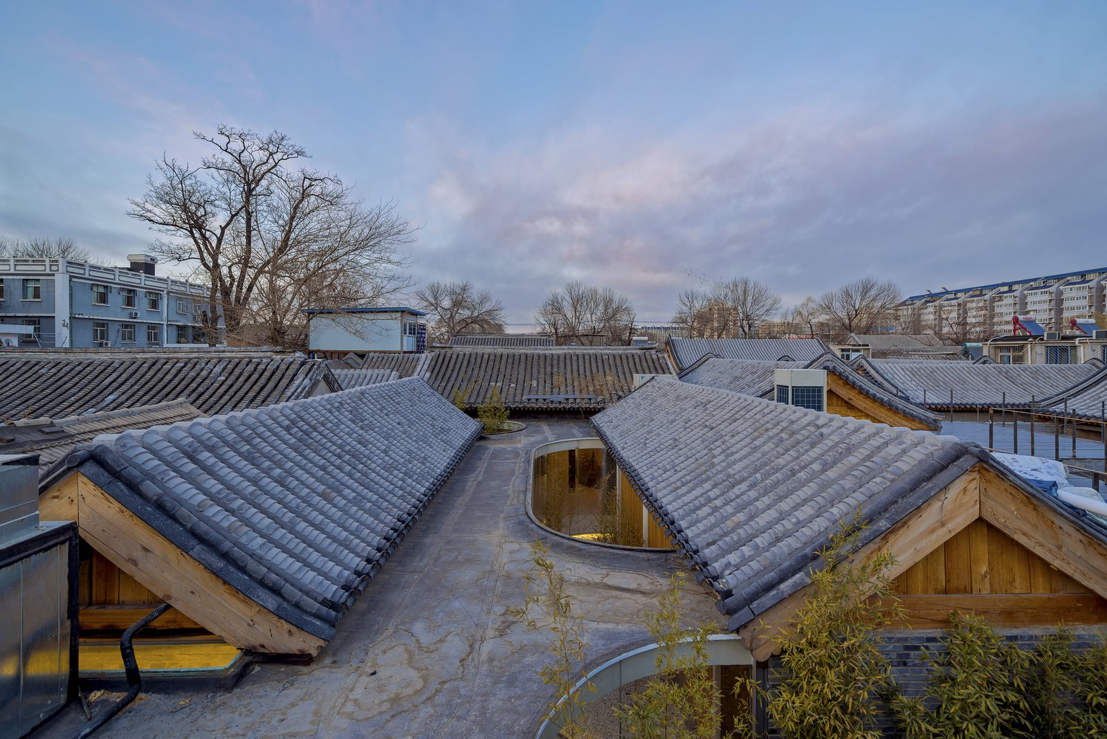 A second view of the tea house's roof with pitched wooden supports visible.  Photo 7 of 7 in An Historic Beijing Structure Gets a Modern Makeover