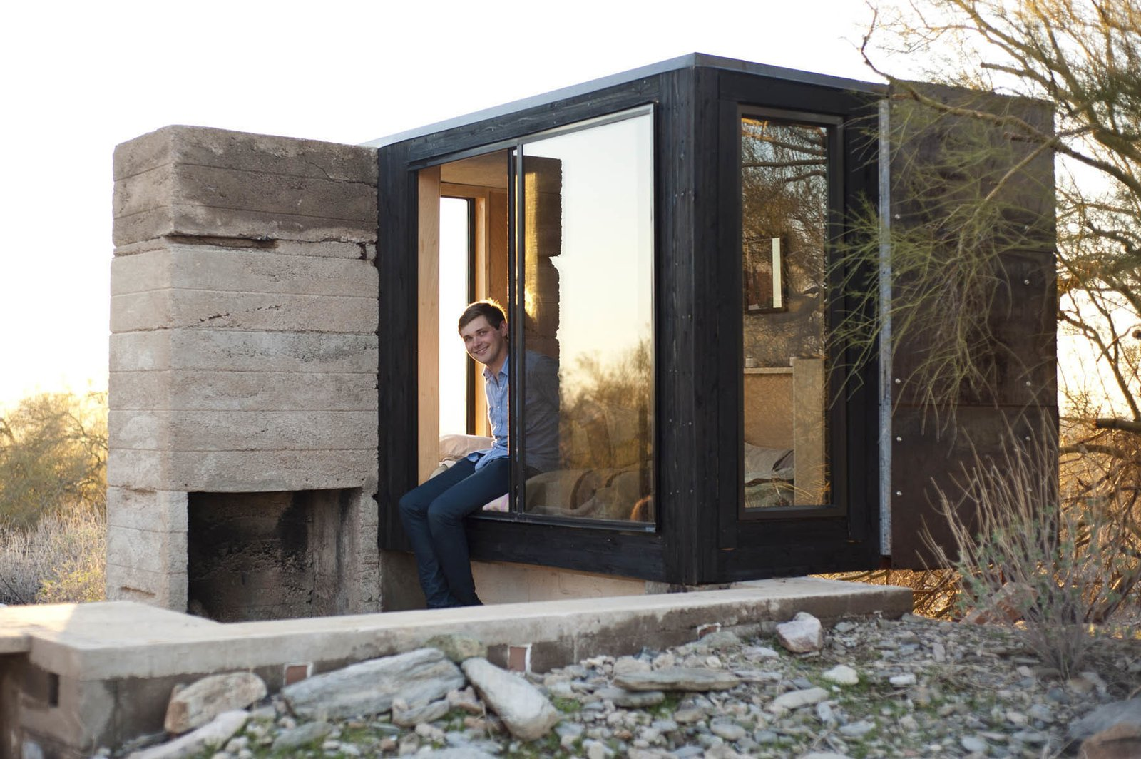 Designed by Taliesin student Dave Frazee, the Miner's Shelter in Scottsdale, Arizona, is a 45-square-foot dwelling that responds to its harsh desert environment with a special metal cover that keeps it shaded at all times.  Copyright Nathan Rist. Cabin by DAVE MORIN