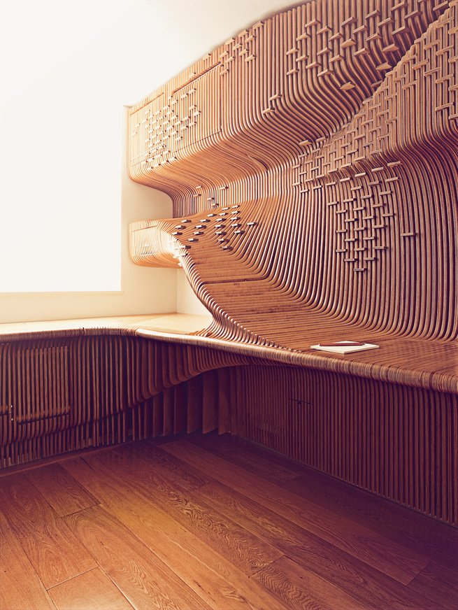 When a London homeowner contacted architect Alvin Huang about building him a sleek and sculptural built-in desk, Huang and his team got creative, hanging sheets of fabricated milled birch to produce a sinuous three-dimensional form. Look closely and you can see the five hidden cabinets that conceal files, books, a phone, and a paper shredder. Additional inset horizontal spacers form an abstract world map and double as a means of holding the boards in place.