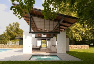 12 Perfect Plunge Pools For Your Small Outdoor Space - Photo 11 of 12 - White-painted brick piers support the structure, which is designed to mimic design elements of the original 1930s farmhouse, approximately 100 yards away.