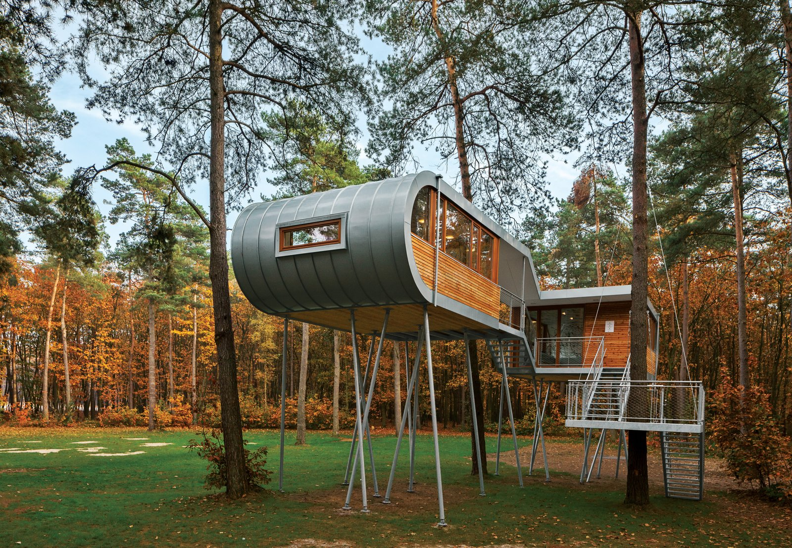 Treehouse by Baumraum, Belgium  Andreas Wenning's firm Baumraum counts over 40 houses, sited in both rural and urban locales, in its portfolio. To reduce impact at this forested site, Baumraum prefabricated a treehouse and craned it atop 19 steel columns, arranging it so that the surrounding trees' roots wouldn't be harmed.  Prefab Homes by Dwell from Sourcing Guide for Modern Prefab Companies in Europe