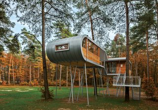 Sourcing Guide for Modern Prefab Companies in Europe - Photo 8 of 11 - Treehouse by Baumraum, Belgium<br><br>Andreas Wenning's firm Baumraum counts over 40 houses, sited in both rural and urban locales, in its portfolio. To reduce impact at this forested site, Baumraum prefabricated a treehouse and craned it atop 19 steel columns, arranging it so that the surrounding trees' roots wouldn't be harmed.