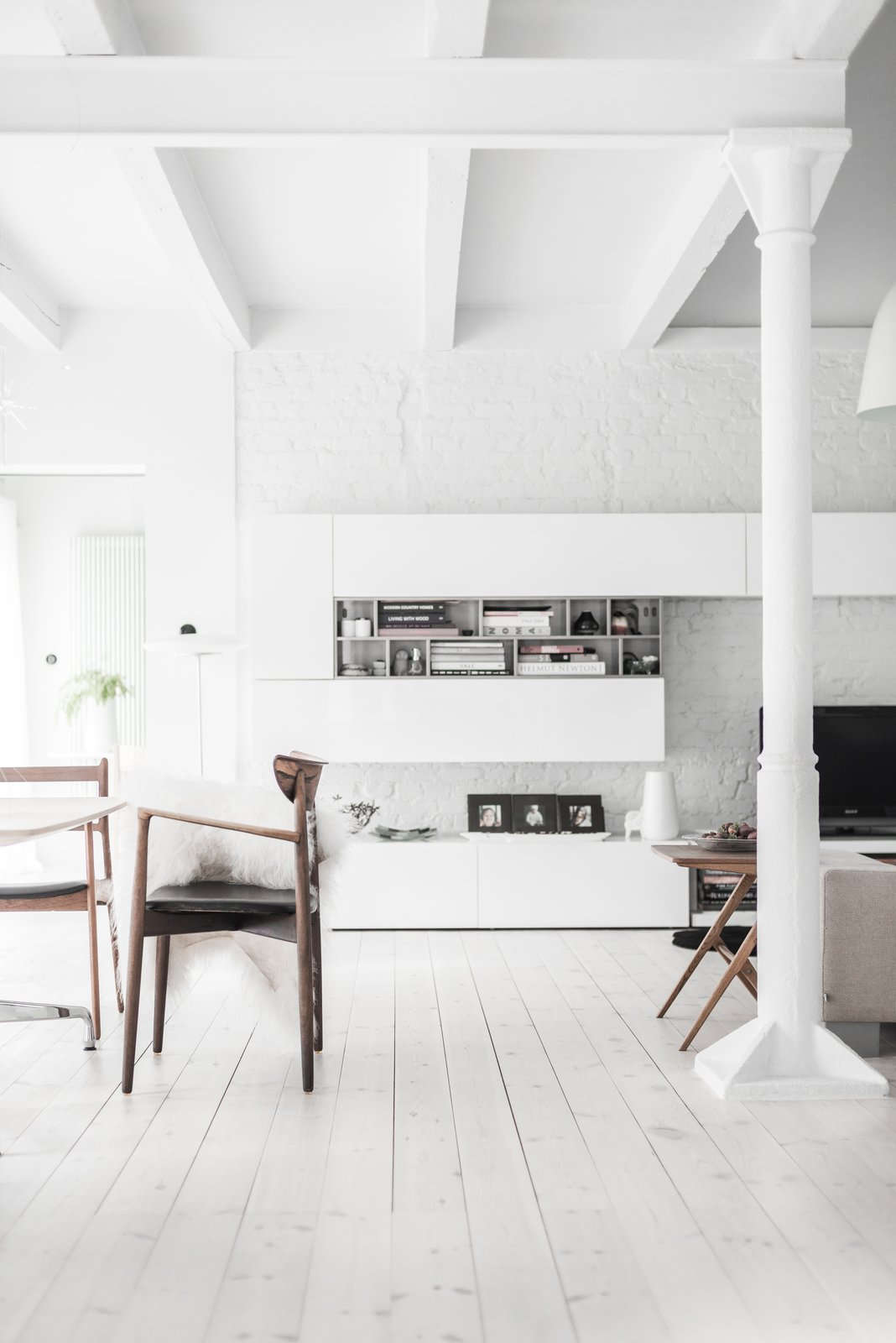 White paint with just a hint of gray dominates the farmhouse, reflecting Kolasiński's love of bright spaces. The pine wooden floors were also enameled in a white oil imported from Denmark.  Farmhouse by Battaglias@hotmail.com from A Run-Down Farmhouse Becomes a Sleek Modern Retreat