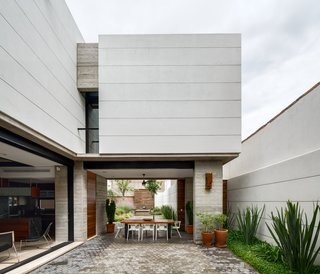 10 Retreats in Mexico For the Modernists Who Love the Outdoors - Photo 6 of 10 - The open and airy courtyard and dining area encourages outdoor living. A custom table made from Andiroba wood and Magis White Air armchairs complete the space.
