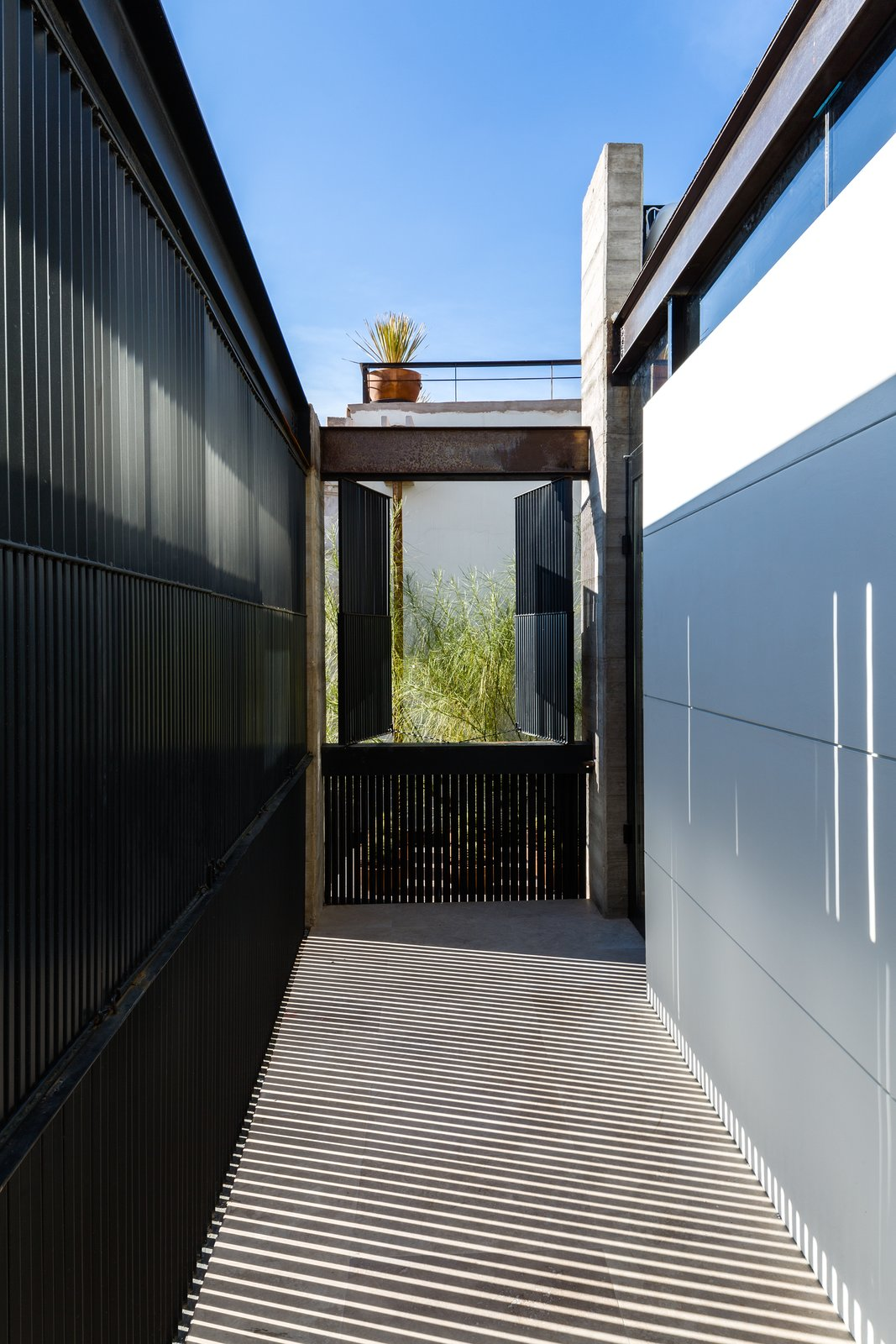 New balconies were constructed to complement the scale of the adjacent openings. The second story balcony was conceptualized as an extension of the room to the street. It can be closed when privacy is required, but opened to the street or terrace for interaction with the natural surroundings. The metallic blinds create dynamic shadow patterns as the light changes throughout the day. Hybrid Home by Sarah Akkoush