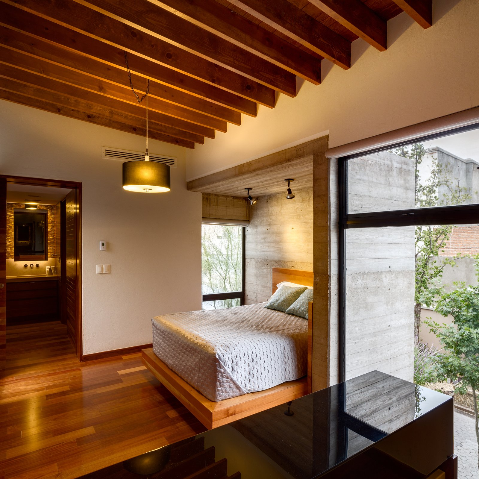 All of the bedrooms, including the master, are incorporated into the program of the new house. The bedrooms are positioned on opposite sides of the second floor; one faces the street and one faces the backyard. The master bedroom bed is tucked into a concrete cube within the room. Hybrid Home by Sarah Akkoush