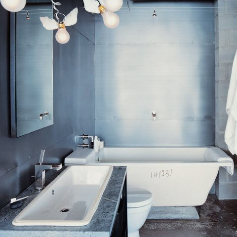 When designer Barbara Hill decided to renovate her 1960s condo in Houston, Texas, she stripped the bathroom down to its bare bones and saw beauty in the blemishes. photos by: Dean Kaufman Bathroom by Clayton Mieritz