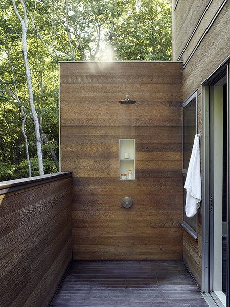 A wood-lined outdoor shower adds a modern touch to one of the decks.