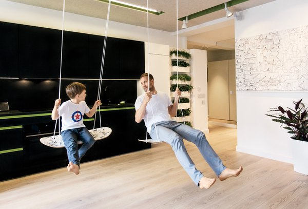"""Inspired by skateboards, the swing seats are made of European oak. """"At first we tried bigger boards, but you can't sit on them,"""" Parzyszek says."""